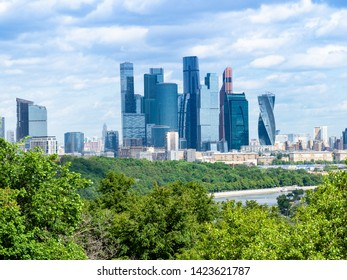 view from observation deck on Sparrow Hills (Vorobyovy Gory) - towers of Moscow-city district on Moskva riverbank in summer day