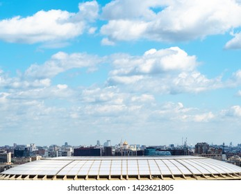 view from observation deck on Sparrow Hills (Vorobyovy Gory) - white fluffy clouds in blue sky over Moscow city in summer day