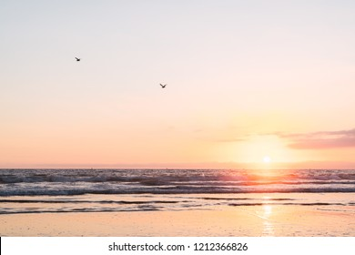 View of ocean with beautiful sunset in Santa Monica pier, Los Angeles, California on bright sky background