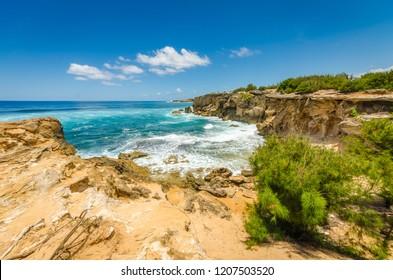 A view of the ocean from the cliffs along the Mahaulepu Heritage Trail in Poipu, Kauai, Hawaii, USA