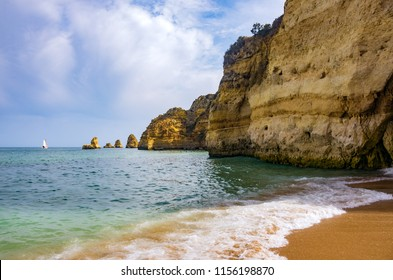 View of the ocean and cliffs in Dona Ana Beach in Lagos, Portugal