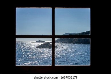 view of the ocean from inside a window