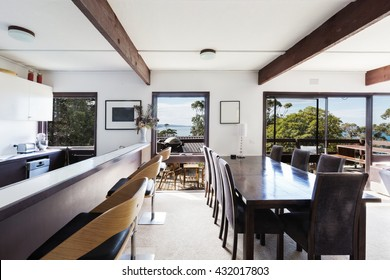 View of the ocean from retro 70sbeach house dining room