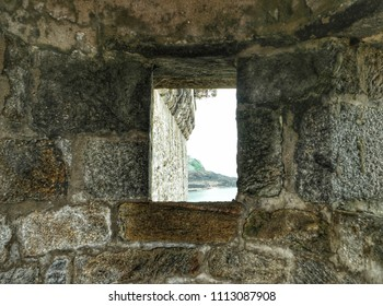 View of the ocean through the loophole of the fortress wall, Saint-Malo, France