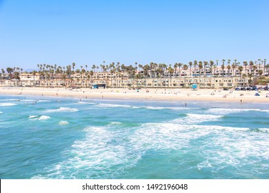 View from Oceanside Pier in California looking back over the buildings and coastline.