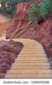 View of the ocher land stairs, in the park Sentiers des Ocres near the village of Roussillon, Vaucluse, Provence, France. Vertical photo. Travel France.