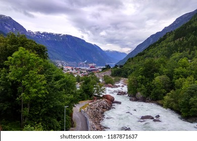 View of the Odda town and Opo river in Hordaland county, Norway. A popular tourist destination located at the end of the Sorfjorden is the base village for hikes to Trolltunga.