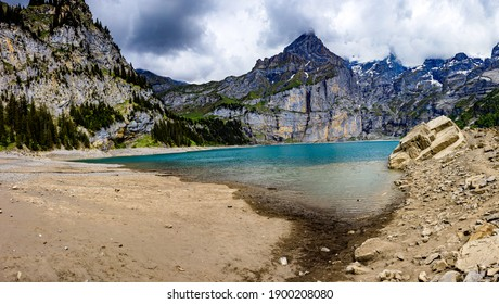 View of the Oeschinensee with clear water and rocks
