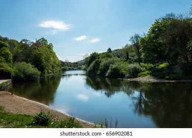 view off the river severn at ironbridge. view shows river, sky and trees.
