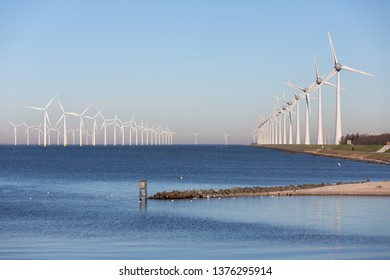 View at off shore wind turbine farm from beach former island Urk, The Netherlands