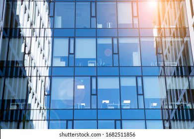 View of office building  with sunrise, reflection and perspective. Bright outlook for business. Modern office block with sunny beautiful sky.