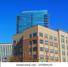 View of office buildings in downtown Ft. Worth,TX as seen from W. Lancaster Avenue.  Clear, blue sky.  Sunny day.