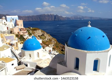 View of Oia, Santorini, Greece with the blue-domed Anastasis Church. The famous blue domed church of Santorini. White walls and blue dome is traditional in Santorini. Church, blue dome, Oia, Santorini