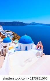 View of Oia in Santorini with greek orthodox church over sea, Greece - Landscape, space for text