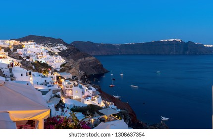 View of Oia village at the sunset - Aegean sea - Santorini island - Greece
