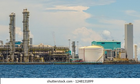 View of the Oil and gas industry, refinery factory petrochemical plant showing main-station of pipelines and towers during sunny day in Labuan Pearl of Borneo, Malaysia