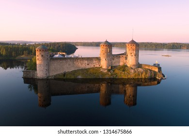 View of the Olavinlinna fortress at sunrise (aerial photography). Savonlinna, Finland (aerial photography). Savonlinna, Finland