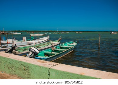 View of old boats in the ocean in Rio Lagartos, Mexico