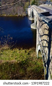 A view of an old bridge crossing the outflow of Loch Tay at Kenmore in rural Perthshire.