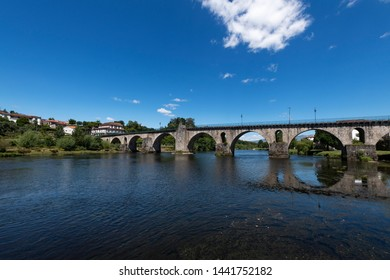 View of the old bridge over the Lima River at the village of Ponte da Barca in the Minho Region of Portugal.