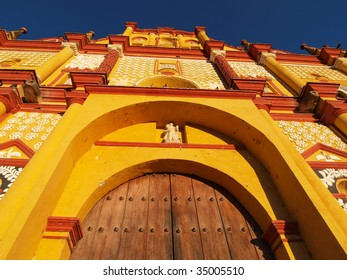 View of old, brightly painted colonial church in town center of San Cristobal de las Casas, Chiapas, Mexico.