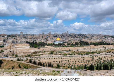 A view of the old city of Jerusalem from the Mount of Olives with the golden Dome of the Rock shining as a result of direct sunlight.