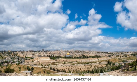 A view of the old city of Jerusalem from the Mount of Olives on a cloudy summer day. The dome of the rock on the Temple Mount is in the centre.