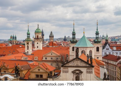 View of old city roofs with The Church of St. Francis, Klementinum, Prague, Czech Republic