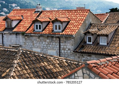 View from Old City Walls in the ancient town of Dubrovnik, Croatia on tiled roofs with a windows
