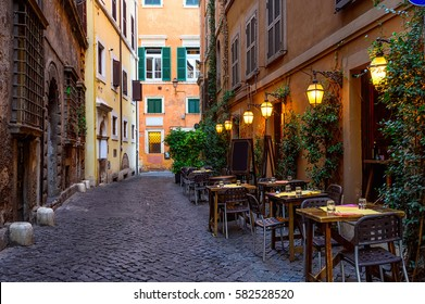 View of old cozy street in Rome, Italy. Architecture and landmark of Rome. Postcard of Rome.