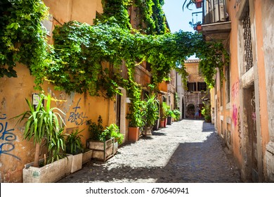 View of old cozy street in Rome. Architecture of Rome. Postcard of Rome. wall background texture. street in the historic Trastevere district. Old town in Europe. Old street in Trastevere.