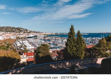 view of old european city on seashore on sunny day, Antibes, France