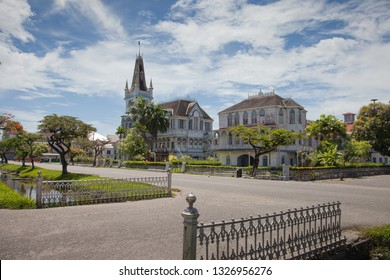 View of the old, fabulous building with a spire and towers, in the Gothic style. Georgetown. Guyana.