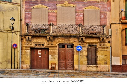 a view of an old facade in old town in Tarragona, Spain