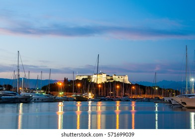 View of the old fortification of Antibes from the modern port at night,France,Europe