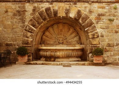 View of old Fountain in the square of Radda in Chianti ( Tuscany Italy)