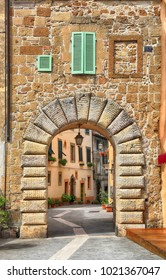 View of old gate and the street in the famous medieval tuff city of Sorano, province of Siena, Tuscany, Italy
