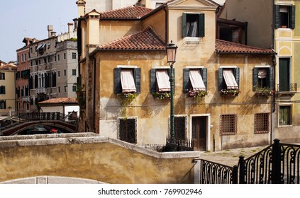 View of old, historical, typical buildings in Venice. Image shows architectural style of region. It is built on more than 100 small islands in a lagoon in the Adriatic Sea.
