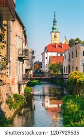 View of old houses and a church by the river in autumn. Picturesque view of the old town Samobor near Zagreb in Croatia.