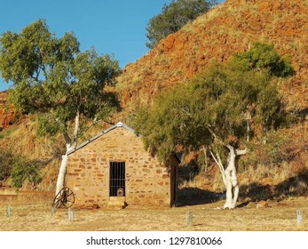 a view of an old hut and ghost gums at the overland telegraph station, barrow creek in australia's northern territory