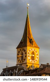 View of the old medieval clock tower in sunset lighting. Zurich. Switzerland.