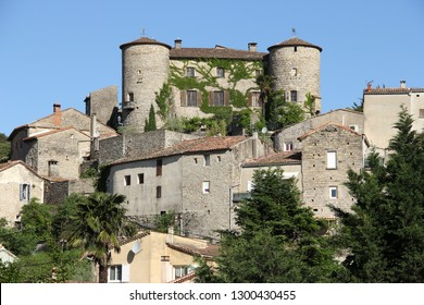 view of an old medieval fortress in the central french mountains