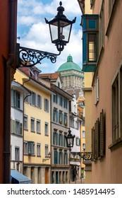 View of the old narrow medieval city street with lanterns. Zurich. Switzerland.