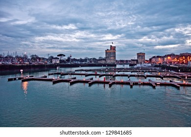 View to old port of La Rochelle city (France) on winter sunset.