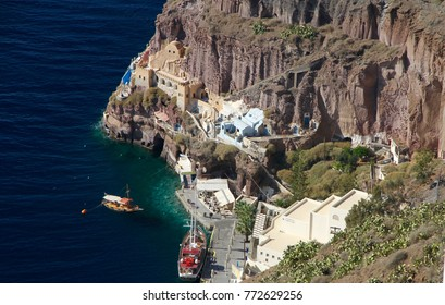 A view of the old port with ships at Fira on Santorini Island, Greece.