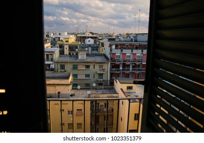View of old quarter block of Bari city, colourful buildings with balconies from the window with shutters, Puglia Apulia region, Southern Italy