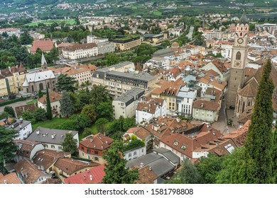 View of Old  Steinach Quarter and New Merano with St. Nicholas Cathedral on the  Cathedral Square and Passirio River in the background, Merano, South Tyrol, Italy.