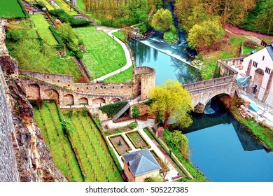 View of a old stone bridge, Grund district and Alzette river in Luxembourg City.