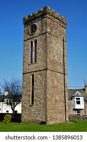 A view of an old stone tower in a graveyard in the Perthshire town of Braco near Gleneagles.