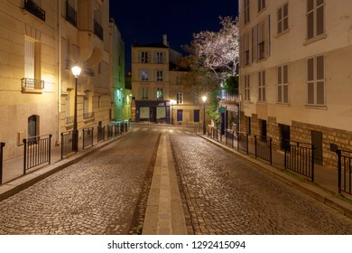 View of the old street on the Montmartre hill in the night lighting. Paris. France.